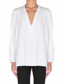 satin blouse, with long sleeves and V-neckline.