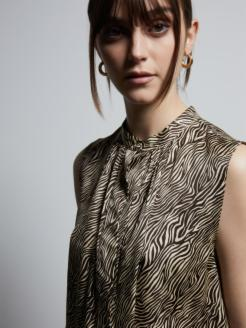 Top in stampa animalier